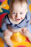 Close-up of a cute baby-boy sitting on a potty stock images