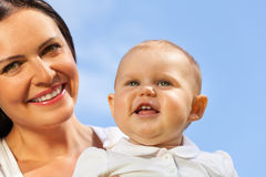 Close-up of cute baby and his mummy over sky Royalty Free Stock Photo
