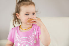 Close up of cute girl eating biscuit Stock Images