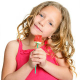 Close up of cute girl holding candy rose. Stock Image