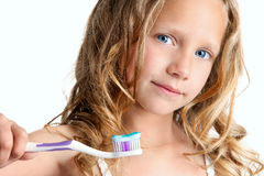 Close up of cute girl holding toothbrush. Close up Portrait of cute little girl holding toothbrush. Isolated on white background Royalty Free Stock Photos
