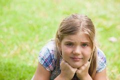 Close-up of a cute girl lying on grass at park Stock Photo