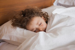 Close-up of a cute girl sleeping in bed Royalty Free Stock Photos