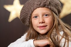 Close up of cute girl wearing beanie. Royalty Free Stock Photo