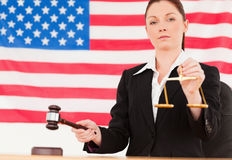 Close up of a cute judge knocking a gavel Royalty Free Stock Photos