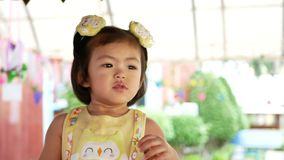 Close up of cute little Asian, Thai, baby girl, 2 years old.  stock video