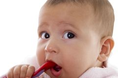 Close up of cute little baby looking aside Stock Images