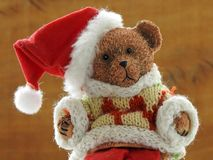 Close-up of a cute little toy bear dressed as Santa Claus royalty free stock photography