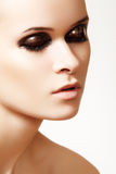 Close-up of cute model with fashion gloss make-up royalty free stock image