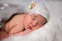 Close up of cute sleeping baby in hat over white Royalty Free Stock Photography