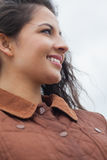 Close up of cute smiling woman in stylish brown jacket Royalty Free Stock Photos