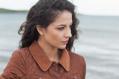 Close up of a cute thoughtful woman on beach Stock Images