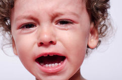 Portrait of a baby boy upset crying. Stock Image