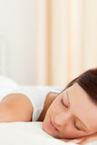 Close up of a cute Woman sleeping in her bed Stock Photography