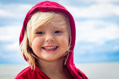 Close-up of cute young boy at the beach. Close-up portrait of a cute, smiling young boy at the beach Stock Image