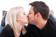 Close-up of cute young couple kissing. With passion on white studio background royalty free stock photography