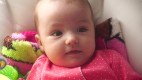 Close up of cute little baby girl. Close up of cutie little baby girl stock footage