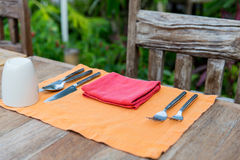 Close up of cutlery with glass and napkin on table Royalty Free Stock Photography