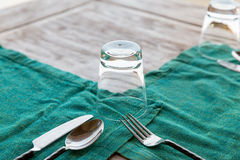 Close up of cutlery with glass and napkin on table Royalty Free Stock Photo