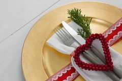 Cutlery with napkin and christmas decoration in a plate. Close-up of cutlery with napkin and christmas decoration in a plate Royalty Free Stock Photos