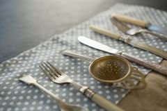 Close up of cutlery on napkin. At table Stock Photo
