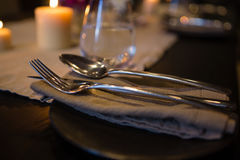 Close up of cutlery and napkin on table Royalty Free Stock Image