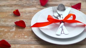 Close up of cutlery tied with red ribbon on plate stock video footage