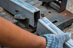 Close-up of cutted steel sections with compound mitre saw and ci Stock Photo