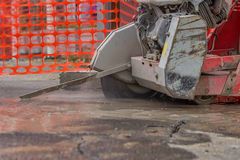 Close up of cutting asphalt road with diamond saw blade Stock Image