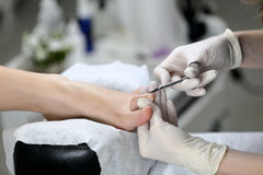 Close up Cutting cuticle on foot, nail scissors Royalty Free Stock Photos