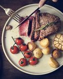 Close up of a cutting a fillet steak food photography recipe ide Royalty Free Stock Photo