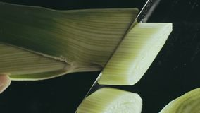 Close-up of cutting leek on a cutting board stock video