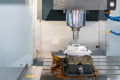 Close up cutting tool working with workpiece by high speed and  accuracy cnc machining center royalty free stock photo