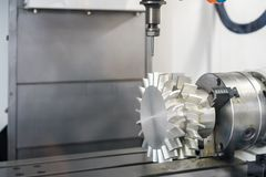 Close up cutting tool working with workpiece propeller  by high speed and  accuracy cnc machining center stock photos