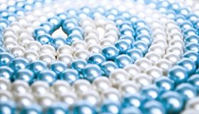 Close-up of cyan and white pearls stock image