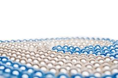 Close-up of cyan and white pearls stock photography