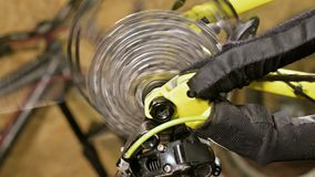 Close-up of the cycling star gear knot when shifting gears in a bicycle repair shop. Bicycle repair.  stock video