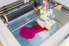 Close Up of 3D printer while printing wrench or spanner. 3D printing in progress. royalty free stock images