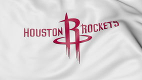 Close-up da bandeira de ondulação com logotipo da equipa de basquetebol de NBA de Houston Rockets, rendição 3D ilustração stock