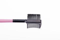 Close-up da escova preta para as sobrancelhas isoladas sobre Imagens de Stock