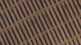 Close-up da esteira do bambu da textura da rotação video estoque