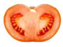 Close up da metade de um tomate isolado no branco Fotografia de Stock Royalty Free