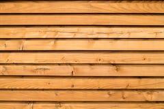 Close up da parede de madeira da casa Imagens de Stock Royalty Free