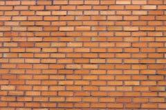Close-up da parede de tijolo de Brown, textura, superfície desigual, fundo fotos de stock royalty free
