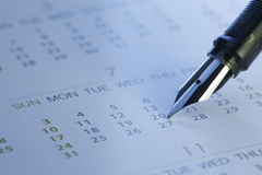 Close-up da pena e do calendário - imagem conservada em estoque Fotografia de Stock