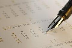 Close-up da pena e do calendário - imagem conservada em estoque Imagens de Stock