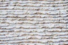 Close-up da superfície da pedra com traços de processamento As linhas paralelas na pedra sairam pela ferramenta de corte Sumário Imagens de Stock