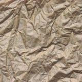 Close-up da textura quadrada de papel de empacotamento enrugada Brown áspera Fotos de Stock Royalty Free