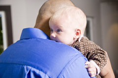 Close up of dad holding baby on shoulder Royalty Free Stock Image