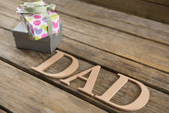 Close up of dad text with gifts Stock Photography